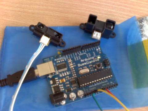 Arduino Duemilanove ATMEGA 328 y sensor Sharp IR